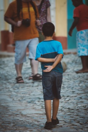A kid is waiting for the ball in a football game in the streets of Trinidad- Cuba