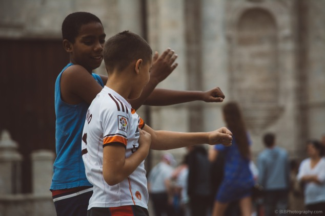 2 kid are celebrating their goals in a street football game in the streets of La Havane- CUBA