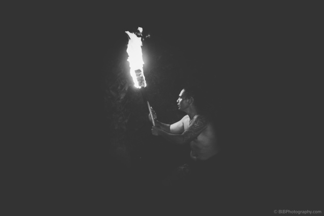 A fire dancer is holding a torch during a Samoan fire demonstration in Kona- Hawaii (USA)