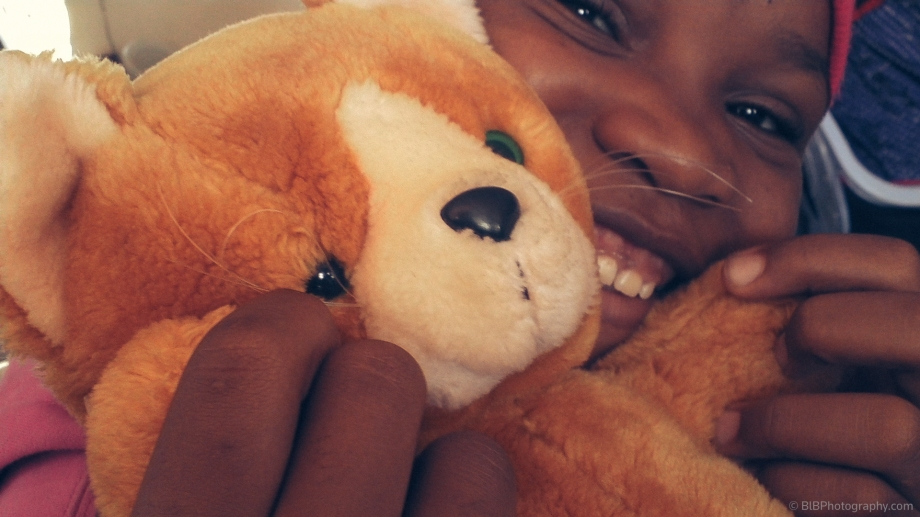 A kid is hugging her teddy bear in Bamenda- Cameroon